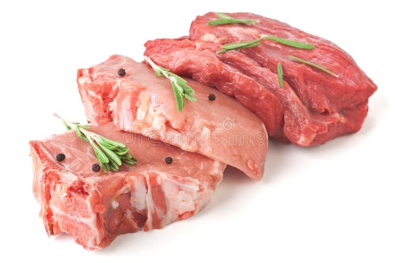 Ruw Varkenskoteletten en Rundvlees royalty-vrije stock foto's