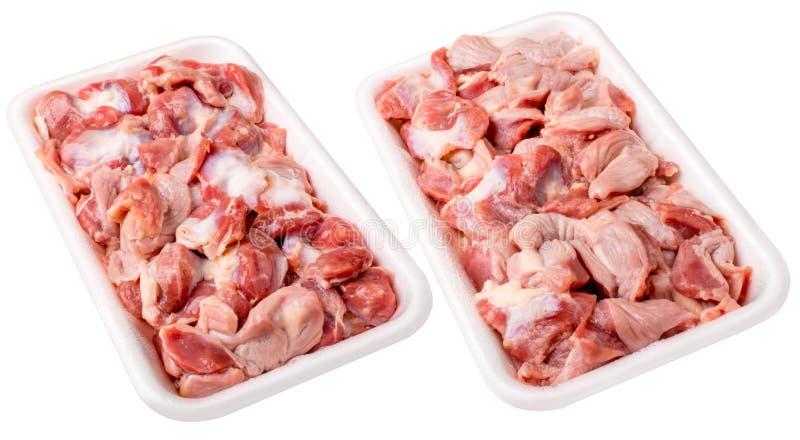 Ruwe bevroren kippenspiermaag in plastic plaat Geïsoleerd op wit royalty-vrije stock foto