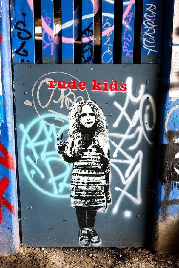 Ruwe de muurkunst van de kindgraffiti, Londen het UK royalty-vrije stock afbeeldingen