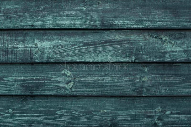 Ruwe groene houten raad Doorstane donkere houten vloer, schuur, dilapidated omheining De muurachtergrond van de hardhouttextuur g stock fotografie