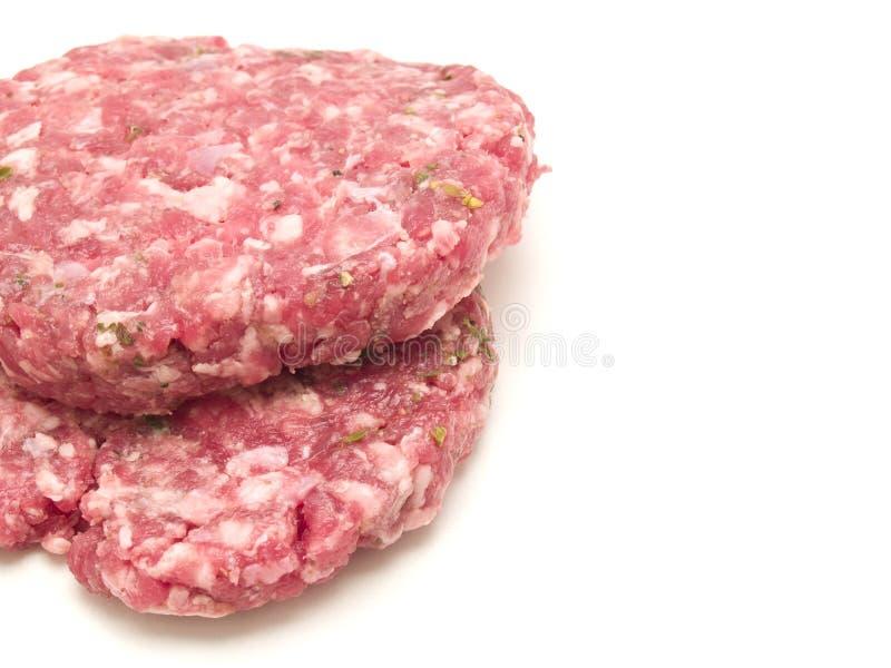 Ruwe hamburger stock afbeeldingen