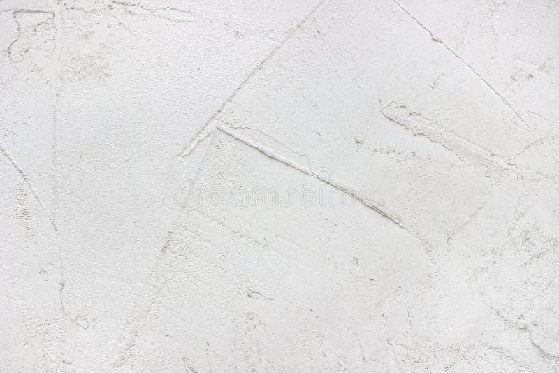 Ruwe pleisteroppervlakte, lege lichte uitstekende achtergrond stock afbeelding