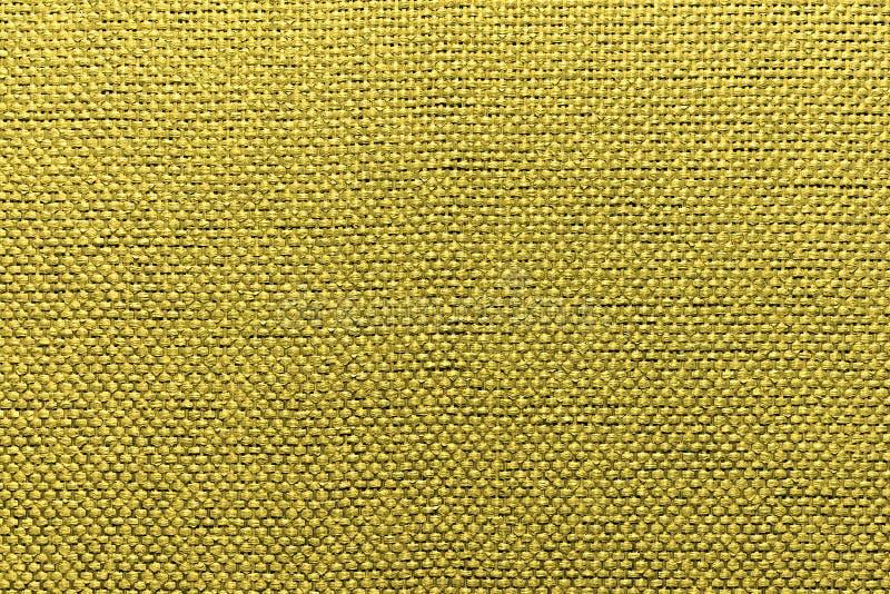 Ruwe textiel gouden achtergrond royalty-vrije stock afbeeldingen