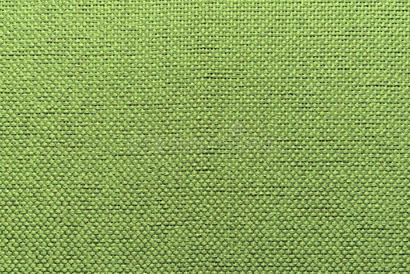 Ruwe textiel warme groene achtergrond stock afbeeldingen