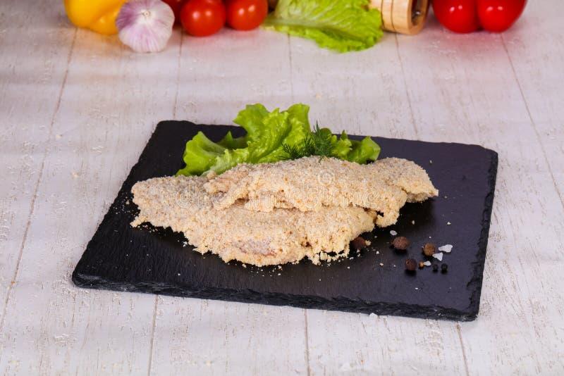 Ruwe Varkensvleesschnitzel stock afbeeldingen