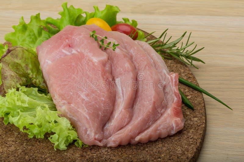 Ruwe Varkensvleesschnitzel stock foto
