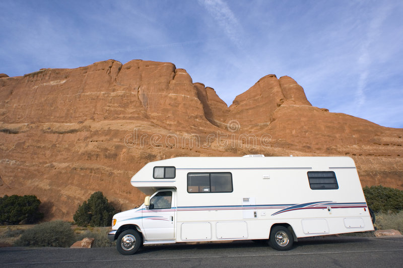 RV against red rock formation royalty free stock photos