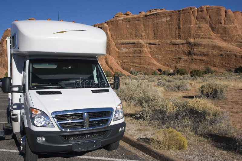 RV against red rock formation royalty free stock images