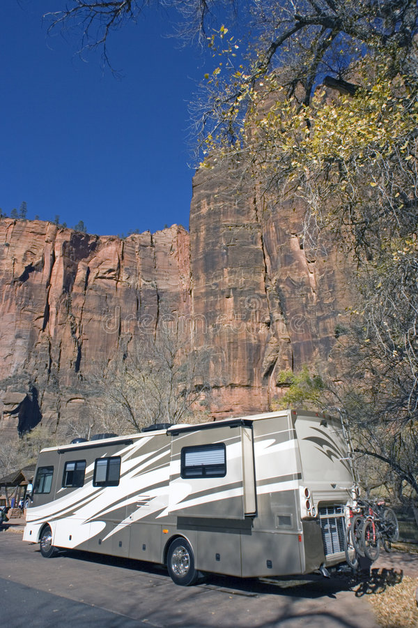 RV against rock formation royalty free stock photography