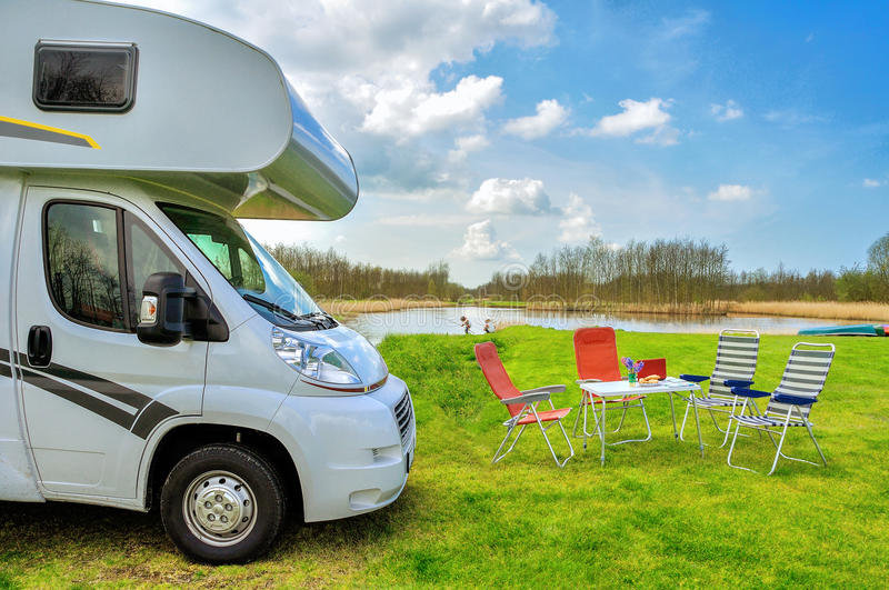RV (camper) in camping, family vacation travel stock images