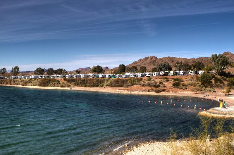 RV Campground on the Colorado River in Arizona. Lake Havasu RV camping along the Colorado River in AZ. Campers over winter at campgrounds in Arizona stock photography