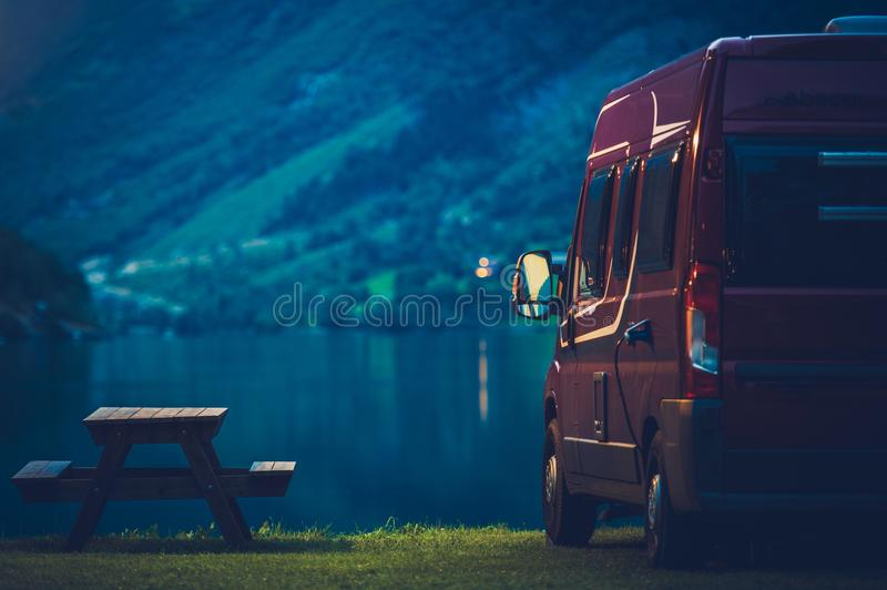 RV Camping at Night. Small Camper Van Overnight Camping royalty free stock photography