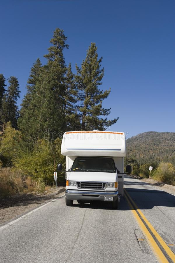 RV driving on mountain road stock images