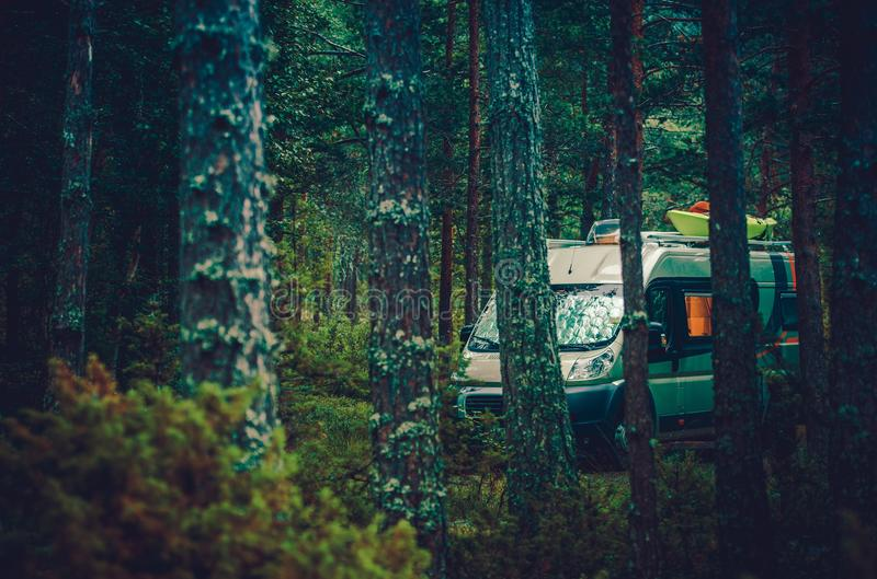 RV Forest Camping. Motorcoach RV Class B Boondocking in Forest. Camper Van Camping royalty free stock photography