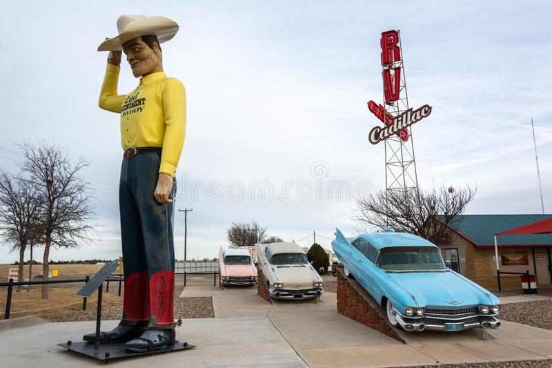 RV Museum in Amarillo, Texas. Amarillo, Texas, United States of America - January 2, 2017. Exterior view of RV Museum in Amarillo, TX, with cars and statue royalty free stock image