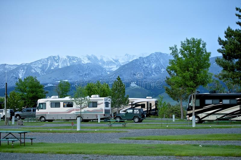 RV Park in Montana. Recreation Vehicles in the RV Park. Montana Mountains on the Horizon. Montana RV Trip stock photos