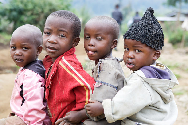 Rwanda children. Rwanda's population density, at 408 inhabitants per square kilometre, is amongst the highest in Africa and lack of space was one of the stock images