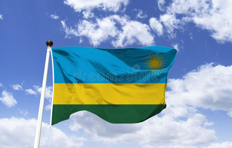 Rwanda Flag Template floating under the blue sky. stock photography