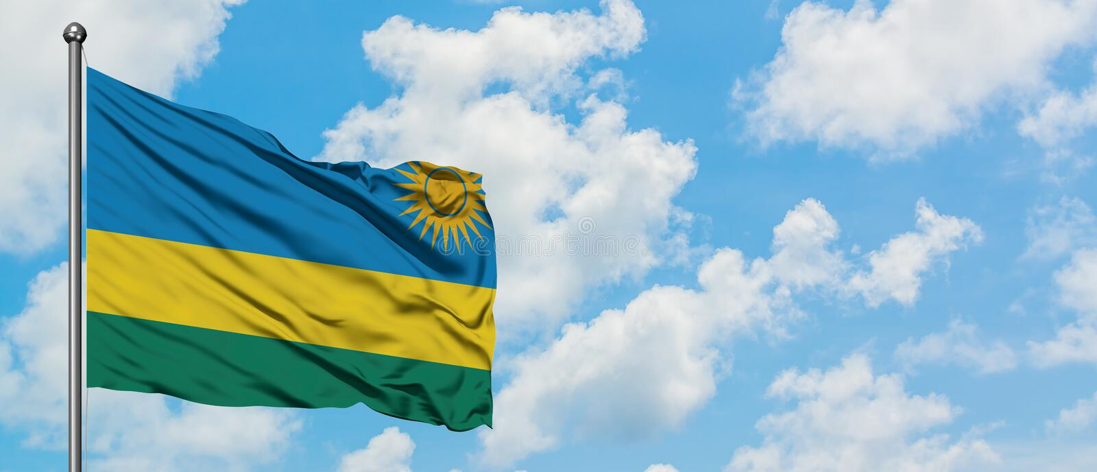 Rwanda flag waving in the wind against white cloudy blue sky. Diplomacy concept, international relations.  royalty free stock photo