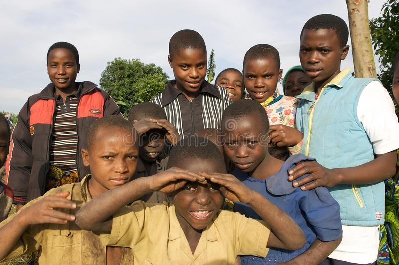 Rwandan children. Rwanda's population density, at 408 inhabitants per square kilometre, is amongst the highest in Africa and lack of space was one of the stock photography