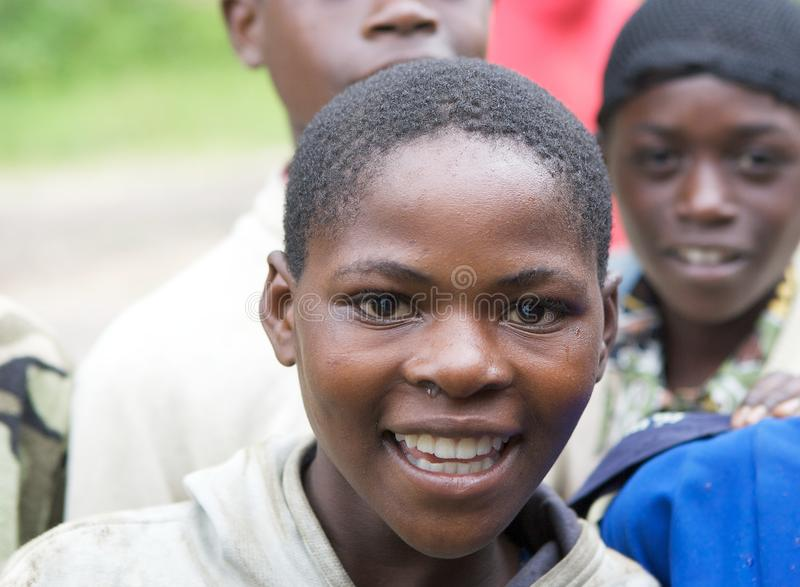Rwandan children. Rwanda's population density, at 408 inhabitants per square kilometre, is amongst the highest in Africa and lack of space was one of the stock images