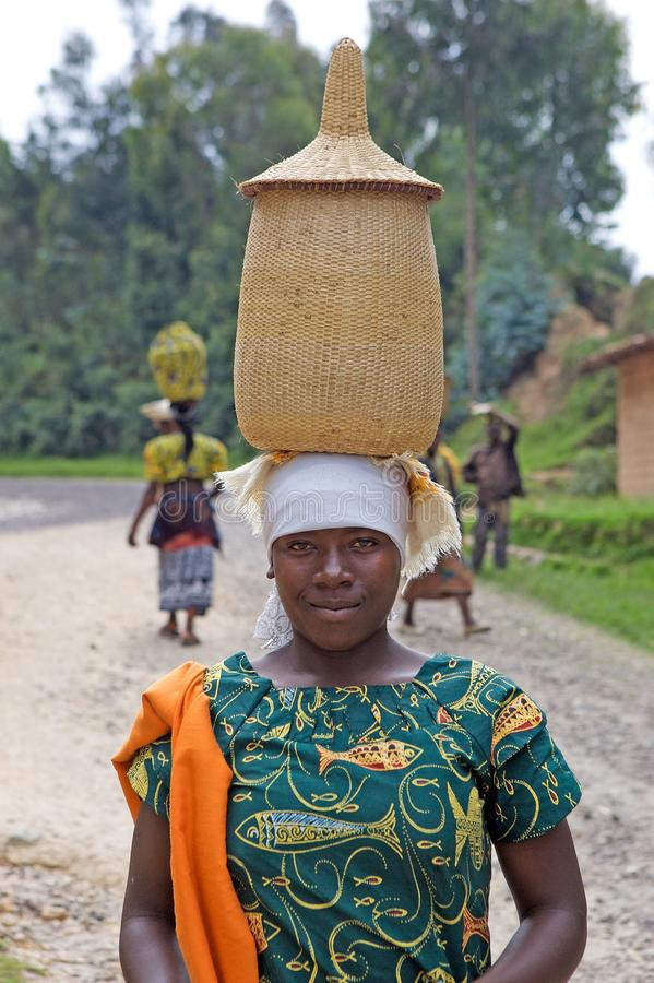 Rwandan woman. Rwanda's population density, at 408 inhabitants per square kilometre, is amongst the highest in Africa and lack of space was one of the stock image