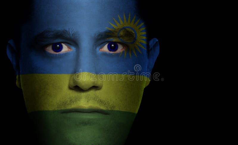 Rwandese Vlag - Mannelijk Gezicht royalty-vrije stock foto