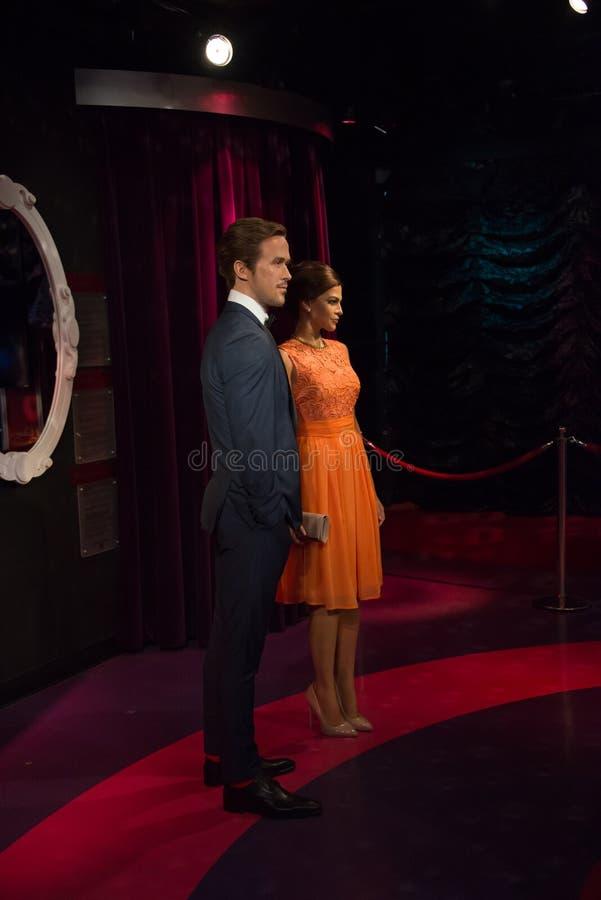 Ryan Gosling och Eva Mendes i museet av madamen Tussauds fotografering för bildbyråer
