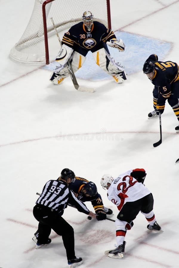 Ryan Miller watches ice hockey faceoff stock photo