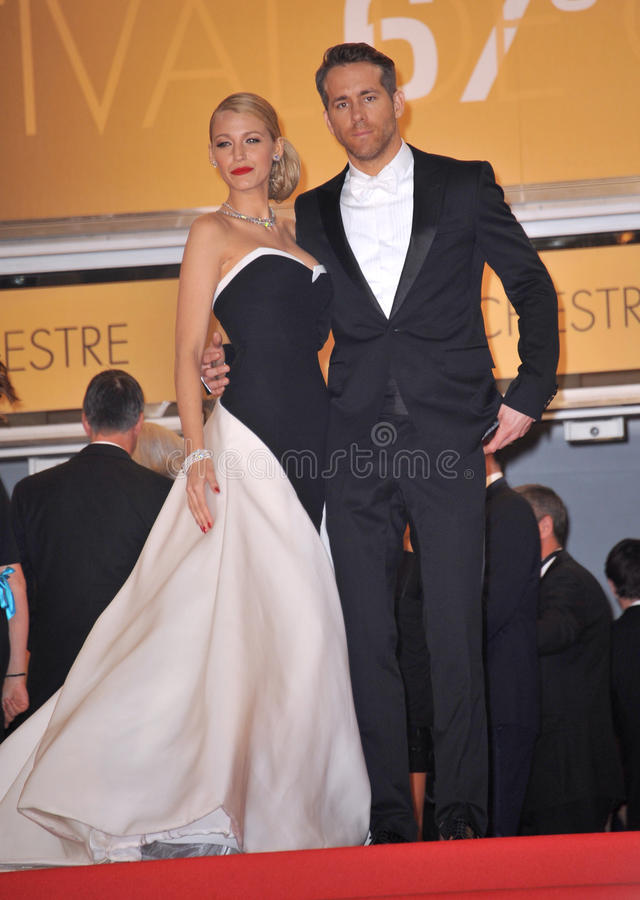 Ryan Reynolds & Blake Lively. CANNES, FRANCE - MAY 16, 2014: Ryan Reynolds & wife Blake Lively at the gala premiere of his movie Captives at the 67th Festival de royalty free stock photo