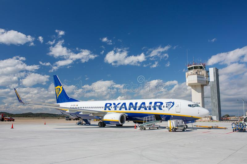 Ryanair airline airplane Boeing 737 in Girona airport in sunny day stock images
