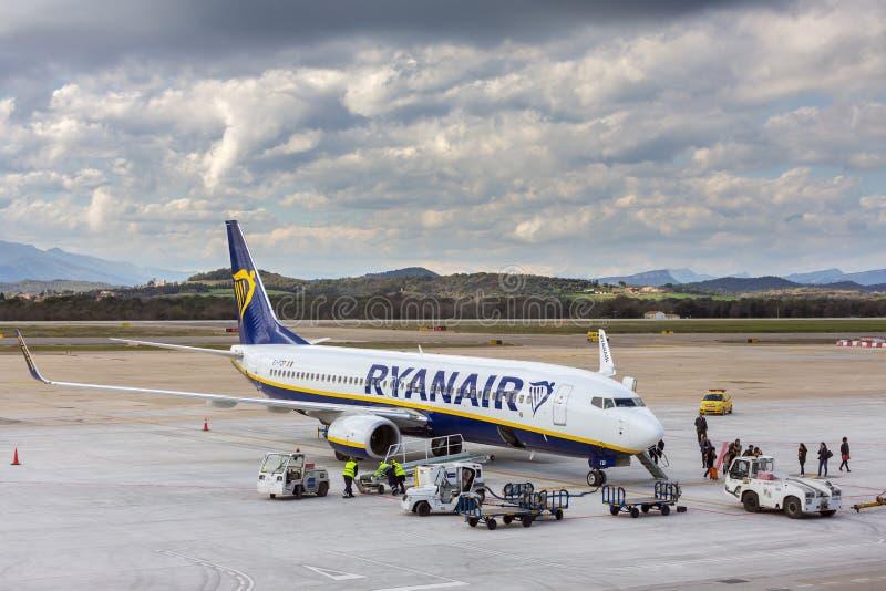 Ryanair airline airplane Boeing 737 in Girona airport in sunny day. Girona, Spain - March 29, 2018: Ryanair airline airplane Boeing 737 in Girona airport in royalty free stock photo