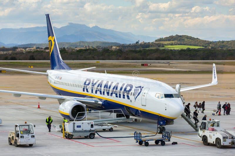 Ryanair airline airplane Boeing 737 in Girona airport in sunny day. Girona, Spain - March 29, 2018: Ryanair airline airplane Boeing 737 in Girona airport in royalty free stock photography