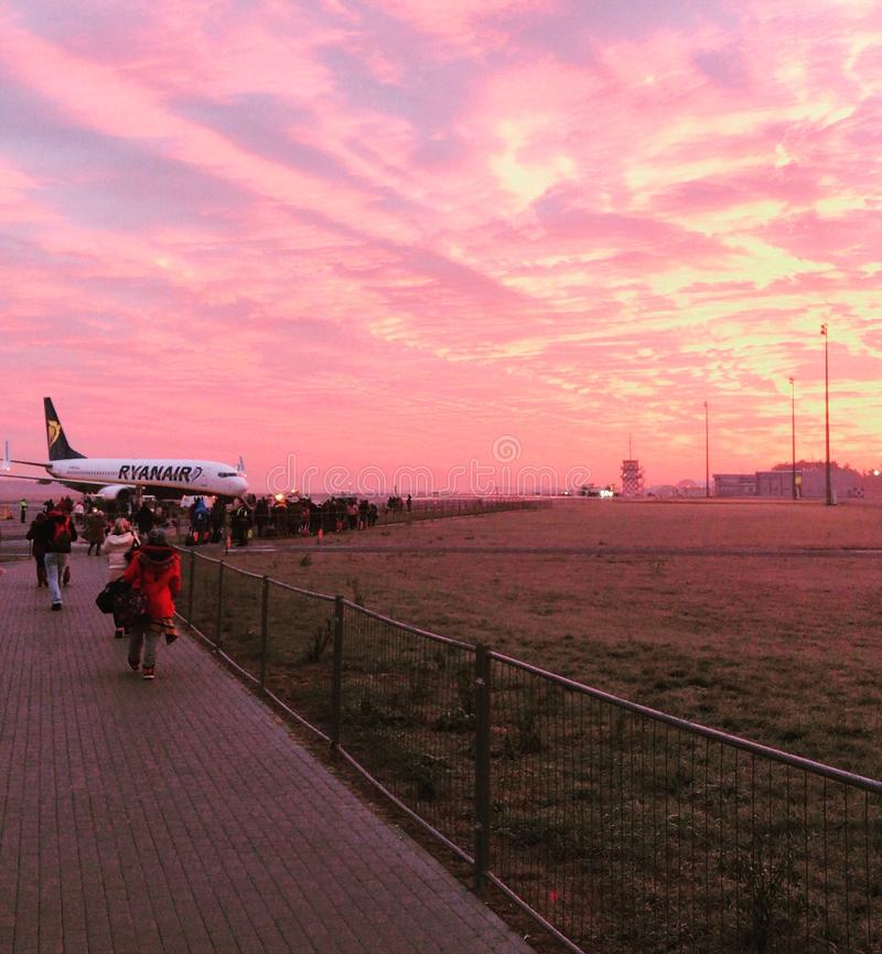 Ryanair airplane at sunrise. Ryanair airplane getting ready to start during beautiful red sunrise, Modlin Airport, Nowy Dwór Mazowiecki, Warsaw, Poland stock photography
