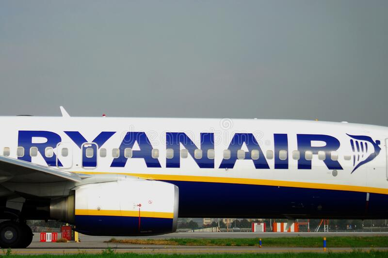 A Ryanair airplane is taxiing at Bergamo`s international airport stock image