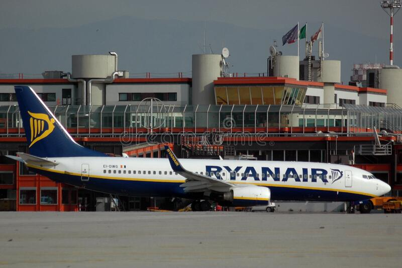 A Ryanair airplane is taxiing at Genoa`s international airport royalty free stock image