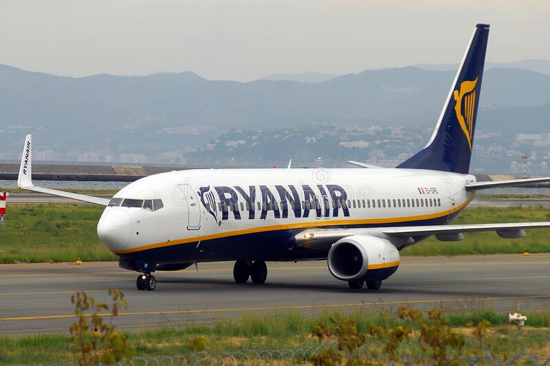A Ryanair airplane is taxiing after landet at Genoa`s international airport stock photography