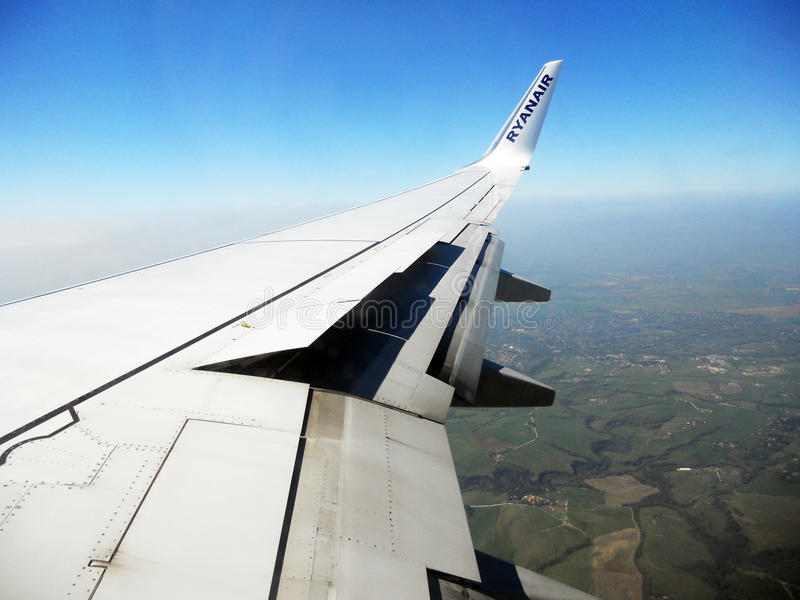 Ryanair wing. A wing of a ryanair flight on the countryside of rome in italy royalty free stock photos