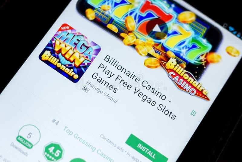 Ryazan, Rússia - 3 de julho de 2018: Casino do multimilionário - jogue os jogos livres app móvel dos entalhes de Vegas na exposiç imagem de stock