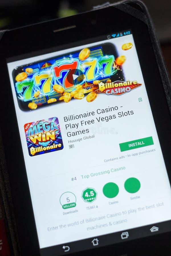 Ryazan, Rússia - 3 de julho de 2018: Casino do multimilionário - jogue os jogos livres app móvel dos entalhes de Vegas na exposiç fotografia de stock