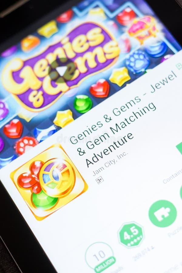 Ryazan, Rusia - 24 de junio de 2018: Genies y gemas - joya y Gem Matching app móvil en la exhibición de la tableta fotos de archivo