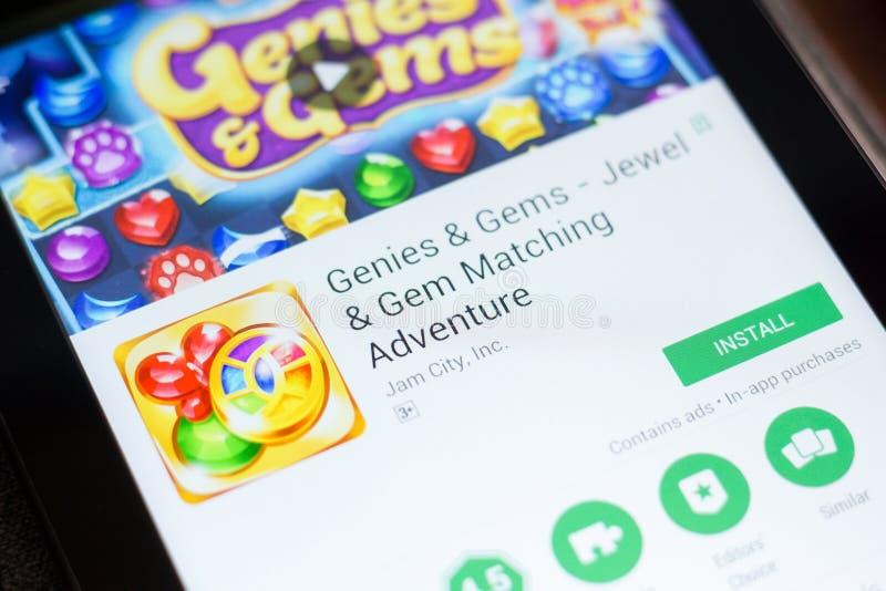 Ryazan, Rusia - 24 de junio de 2018: Genies y gemas - joya y Gem Matching app móvil en la exhibición de la tableta fotos de archivo libres de regalías