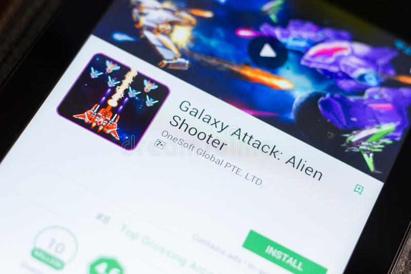 Ryazan, Russia - June 24, 2018: Galaxy Attack Alien Shooter Game mobile app on the display of tablet PC. royalty free stock photos