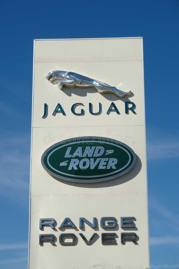 Ryazan, Russia - 15 may, 2017: Jaguar, Land Rover dealership sign against blue sky. stock photo