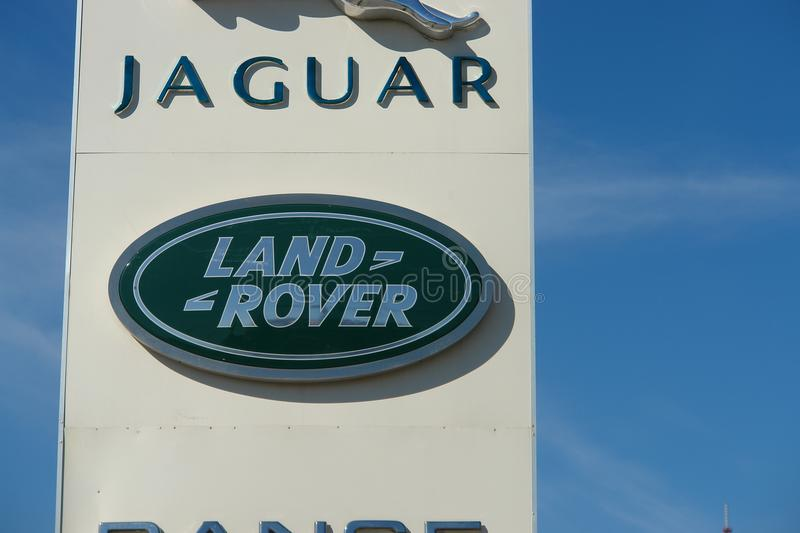 Ryazan, Russia - 15 may, 2017: Jaguar, Land Rover dealership sign against blue sky. royalty free stock photos