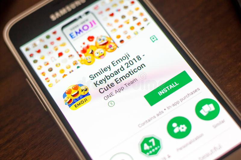 Ryazan, Russia - May 04, 2018: Smiley Emoji Keyboard mobile app on the display of cell phone. Ryazan, Russia - May 04, 2018: Smiley Emoji Keyboard mobile app on stock photo
