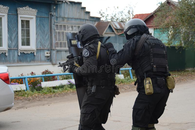 Soldiers of the police detachment of special purpose `Thunder` conduct training to neutralize terrorists royalty free stock photo
