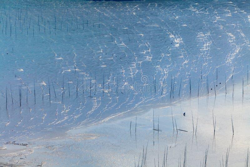 Rybacy na dużej plaży w Xiapu, Fujian prowincja, Chiny obrazy stock