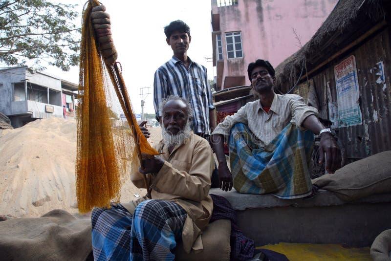 Rybak wyplata sieć rybacką zdjęcie stock