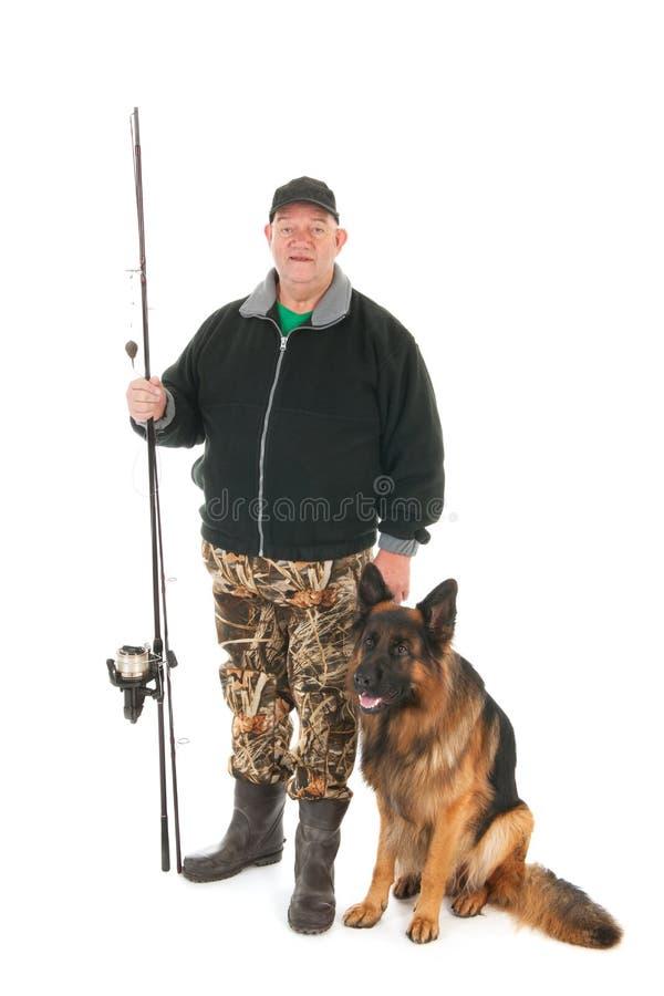 Rybak z połowu psem i prąciem fotografia stock